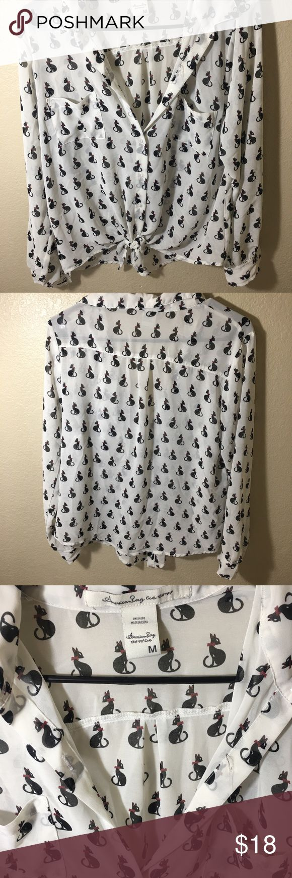 BOGO 50% off American Rag Black Cat top American Rag Black Cat off white long sleeve blouse  Size Medium  Gently used - great condition  Button up with front tie  Perfect for cat lovers  Flash SALE! Buy one get one 50% Buy today it ships today!  Discount applied to lowest priced item(s) - Don't forget to bundle.  One day sale only!   Feel free to ask any questions, and Happy Poshing! American Rag Tops Button Down Shirts