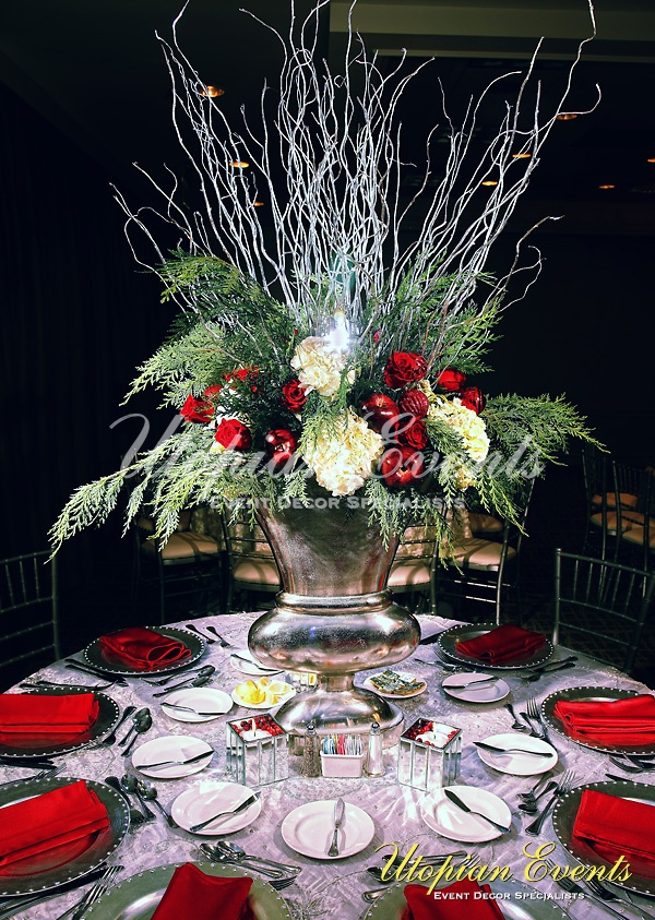 A wintery floral centerpiece in a silver urn perfect for Christmas.