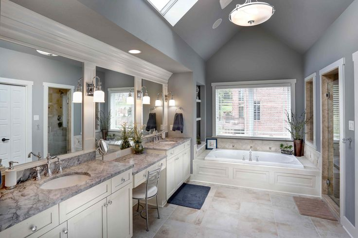 Skylights and a cathedral ceiling provide added spaciousness to this Barrington Homes bathroom. #housetrends