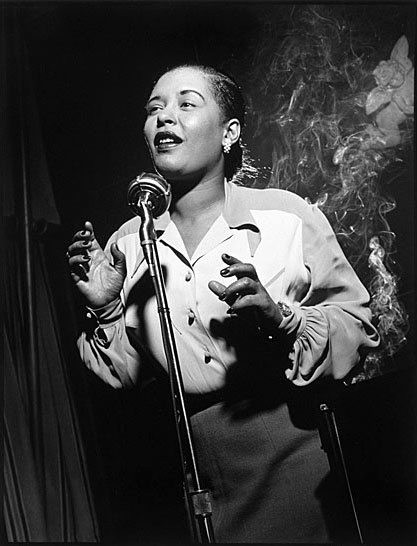 """Billie """"Lady Day"""" Holiday was an American jazz singer & songwriter. She had a seminal influence on jazz & pop singing. Her vocal style, strongly inspired by jazz instrumentalists, pioneered a new way of manipulating phrasing and tempo. Critic John Bush wrote that she """"changed the art of American pop vocals forever."""" She co-wrote only a few songs, but several of them have become jazz standards, notably """"God Bless the Child"""", """"Don't Explain"""", & """"Good Morning Heartache"""", & """"Strange Fruit""""."""