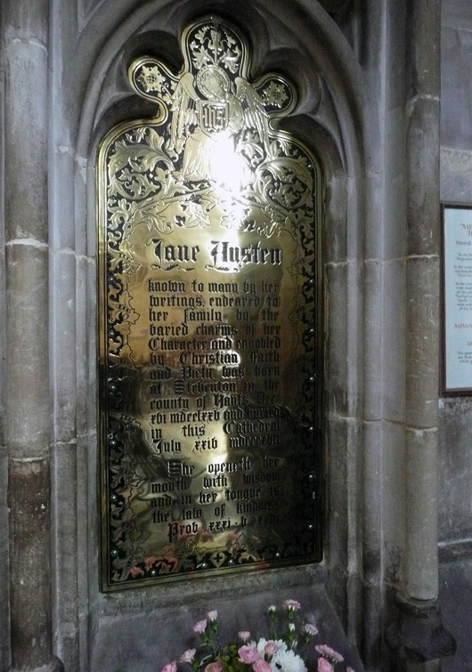 "Jane Austen's grave in Winchester Cathedral. The plaque above her grave, which mentions her literary achievements was put there after her death, because at the time it wasn't suitable for a woman to write. Jane Austen's novels had all been published without even mentioning her name, just with the indication ""by a lady""."