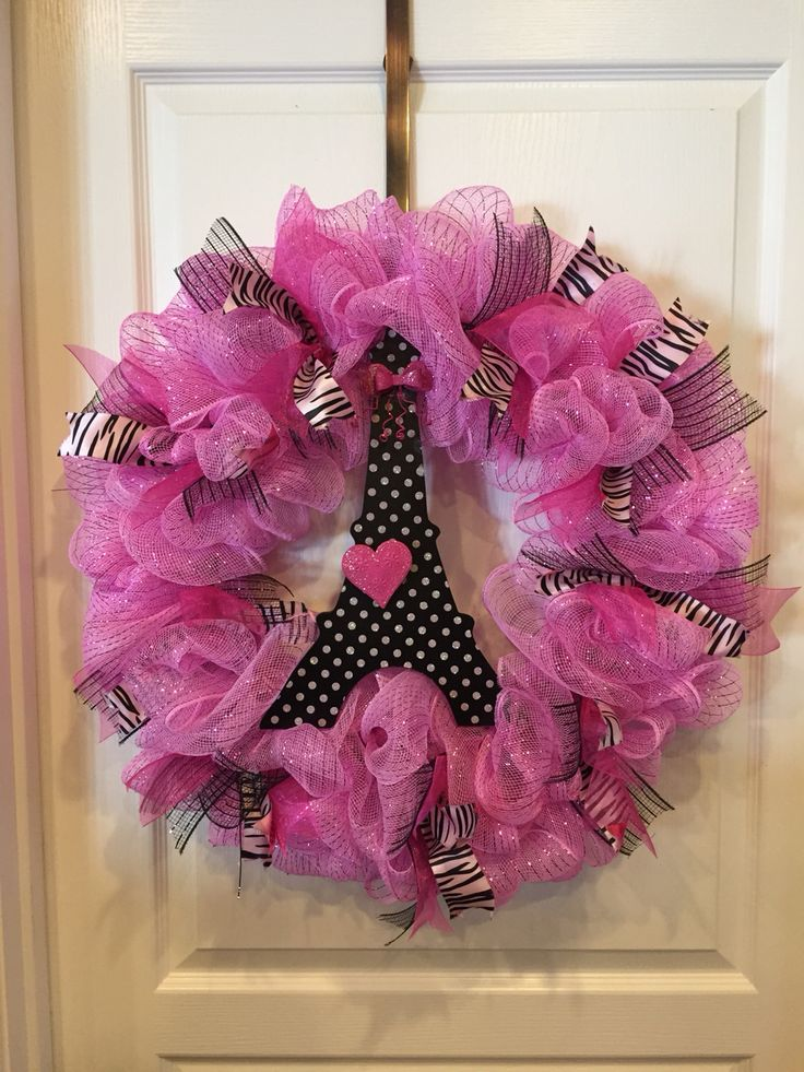 Paris themed pink deco mesh wreath, with hot pink and zebra ribbon I made for Kendall's 9th birthday party.  The Eiffel Tower was a valentine decoration I got at Hobby Lobby for 90% off!