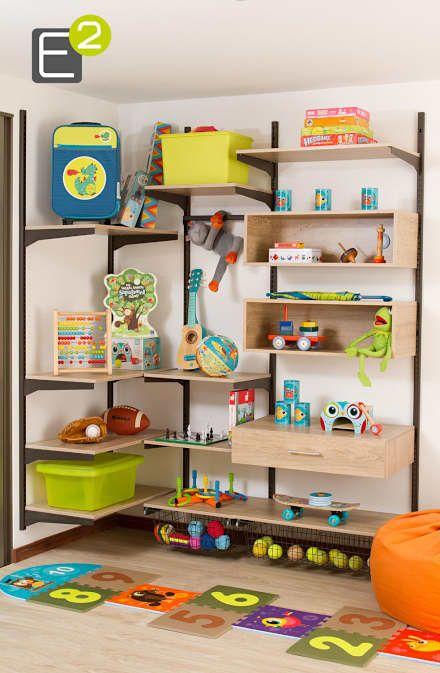 Cuarto infantil / Juguetes: Habitaciones para niños de estilo moderno por Espacio al Cuadrado