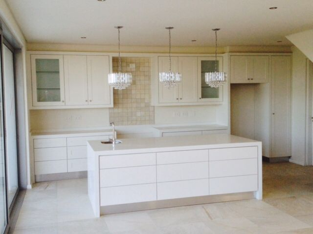 Duco kitchen with touch drawers and Snow White Ceasarstone.