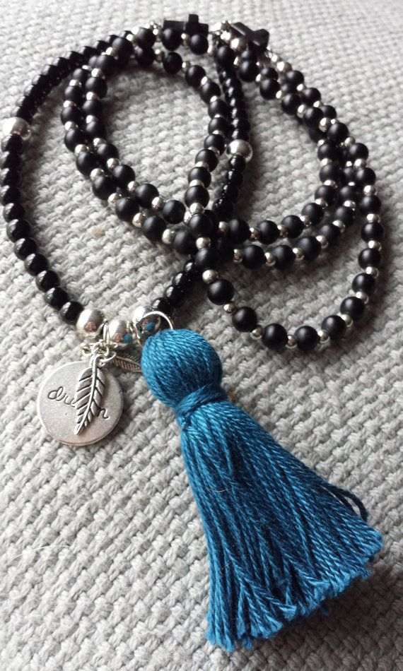 Obsidian and carved Magnesite cross wrap by BeanCreationsbyGill, $30.00