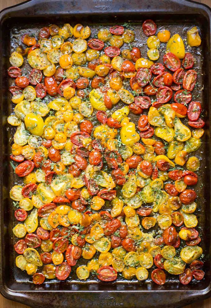 Garlic and Herb Roasted Tomatoes - these incredibly flavorful roasted tomatoes are wonderful in salads, pasta dishes, on pizzas, sandwiches and a myriad of other uses!