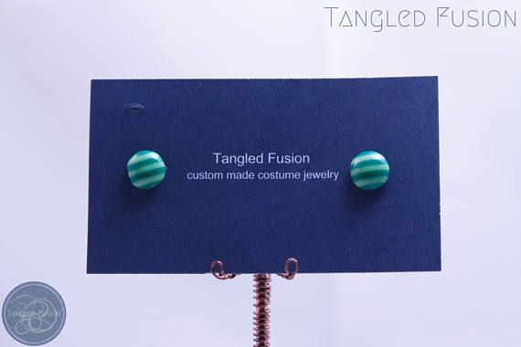 Quirky Handmade Stripe Stud Earrings https://www.etsy.com/au/listing/538073331/quirky-handmade-stripe-stud-earrings?ref=shop_home_active_4  Handmade stripe stud earrings with acrylic and silver plate findings   Colour: Dark Green & Light Green Stripe   Tangled Fusion offers a wide scope of quirky, fun jewellery and handmade creations.