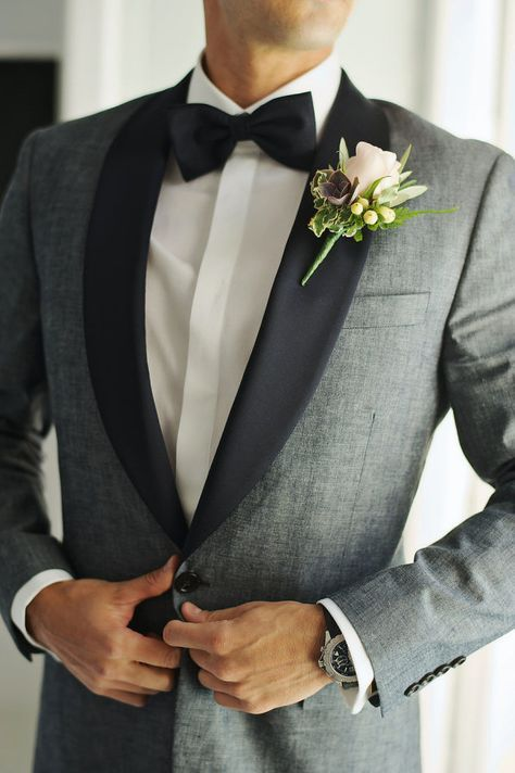 Dapper grey tux and black bow tie: http://www.stylemepretty.com/destination-weddings/2016/10/07/this-adventure-loving-duo-tied-the-knot-in-greece-and-it-was-awesome/ Photography: Thanasis Kaiafas - http://www.thanasiskaiafas.com/