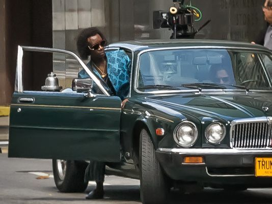 """'Miles Ahead' movie rolls into town in style. Photo: Actor-director Don Cheadle gets into a green classic Jaguar on set of the """"Miles Ahead"""" film about jazz icon Miles Davis Monday. The Enquirer/Madison Schmidt"""