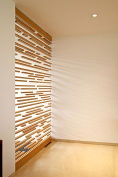 Love this dividing wall and how it lets light through. Some of the wood pieces appear to be floating.