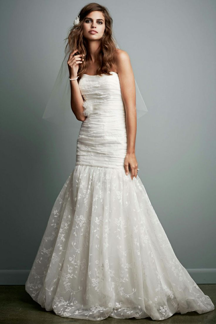 Galina gown, available exclusively at David's Bridal. This model looks weird but the dress is pretty.