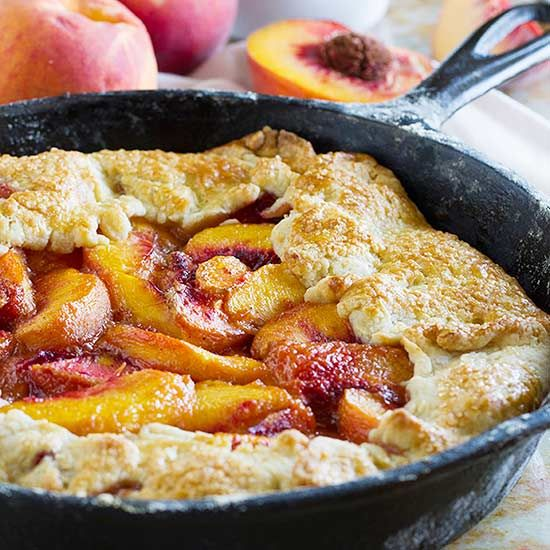 This beautifully rustic dessert featuring fresh sweet peaches is baked right in an old-fashioned cast-iron skillet.