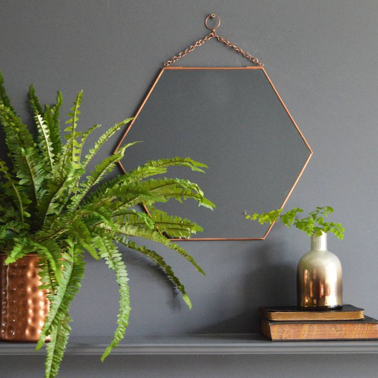 A stylish copper hexagonal mirror.You can never have too many mirrors and this dainty hexagonal copper mirror fits the bill perfectly, it's also a great way to inject some of the current season's metallic trend into your home décor. With a copper coloured iron frame and chain for hanging, this mirror is made by Danish brand, &K and is ideal for the contemporary home.Zinc with a copper coloured coating and glass.H35 x W40cm Chain- L7cm
