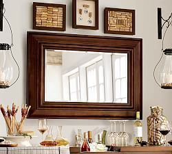 I like the way this Pottery Barn mirror is surrounded by small decorative items and wall sconces.
