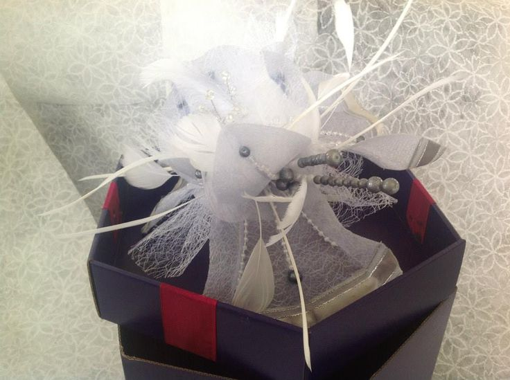 Subtle tones of grey and white, spiraled with fathers and you have and amazing crown for weddings and events