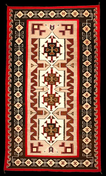Navajo Rug, Teec Nos Pos Trading Post. The Teec Nos Trading Post style was influenced by the oriental rugs with multiple borders and lots of colors. This is one of the finest rugs woven. The weaver re-wove the unusual, irregular beige lines inside the diamond to achieve a perfectly symmetrical design (shown in the closeup photograph). Important and rare Navajo textiles and weavings for sale on CuratorsEye.com