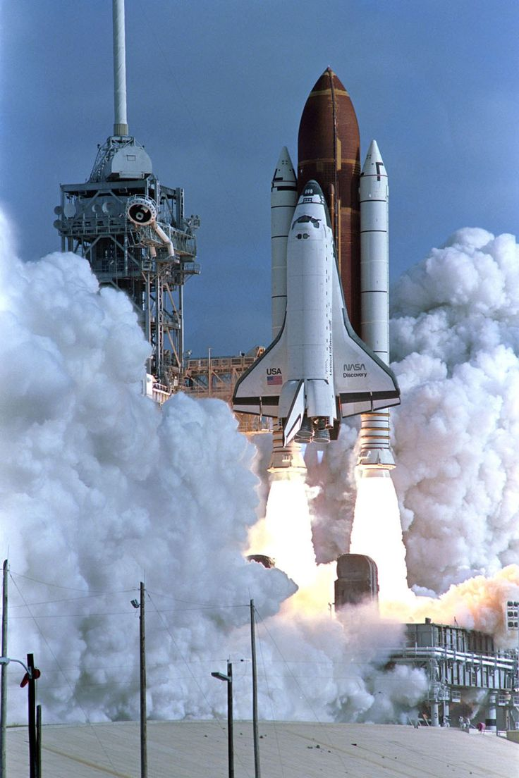 In this dated April 24, 1990 filed photo shows the Shuttle Discovery lifts off launch pad, carrying a crew of five and the Hubble Space Telescope