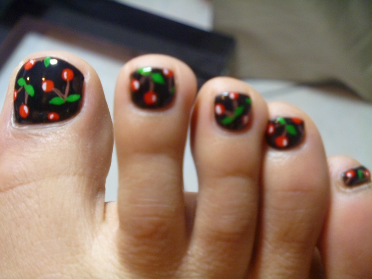 Cherries on black. Feet seriously creep me out but this is really cute, I want on mine.