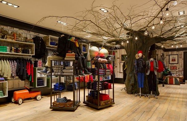 """HACKETT London UK, Kidswear,""""A large decorative tree that will be themed and change with the season is central to the children's area"""", pinned by Ton van der Veer"""