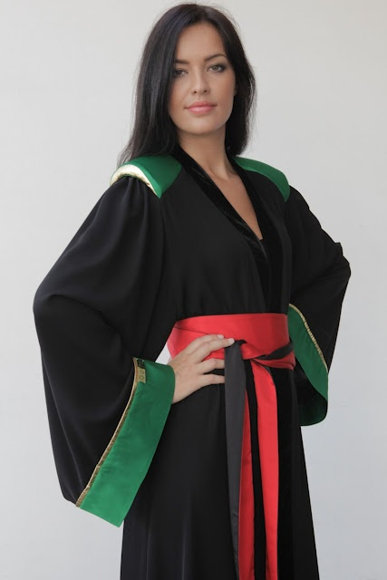 Elegant abaya, I think it's Omani designer, not sure.