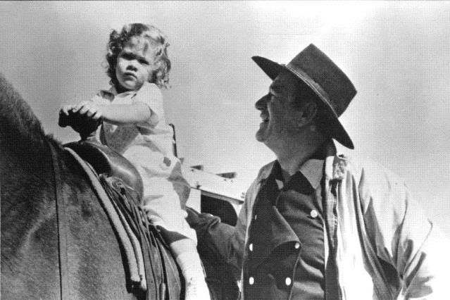 dedicatedtoduke:  On the set of Horse Soldiers, 1959, with daughter Aissa, born in 1956, to his third wife Pilar Pallete
