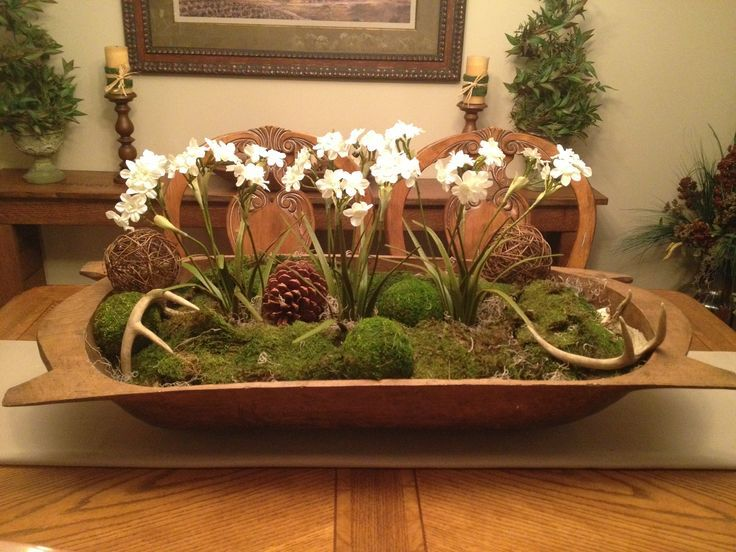 Dough Bowl Centerpiece with flowering plants and moss balls, has lots of other photos of how to decorate with dough bowls
