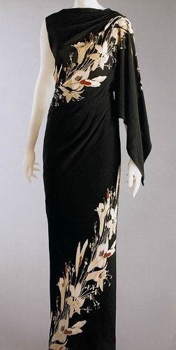 Schiaparelli 1935. Beautifu. ltalian designer Schiaparelli became popular due to being inspired by the surrealist art movement. This dress shows the idea of using print in a away thats not uniform or geometric.