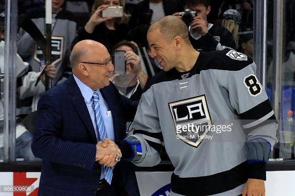 Los Angeles Kings broadcaster Bob Miller shakes hands with Jarome Iginla #88 of the Los Angeles Kings after a game against the Chicago Blackhawks at Staples Center on April 8, 2017 in Los Angeles, California. #LAKings #WeAreAllKings #ThankYouBob