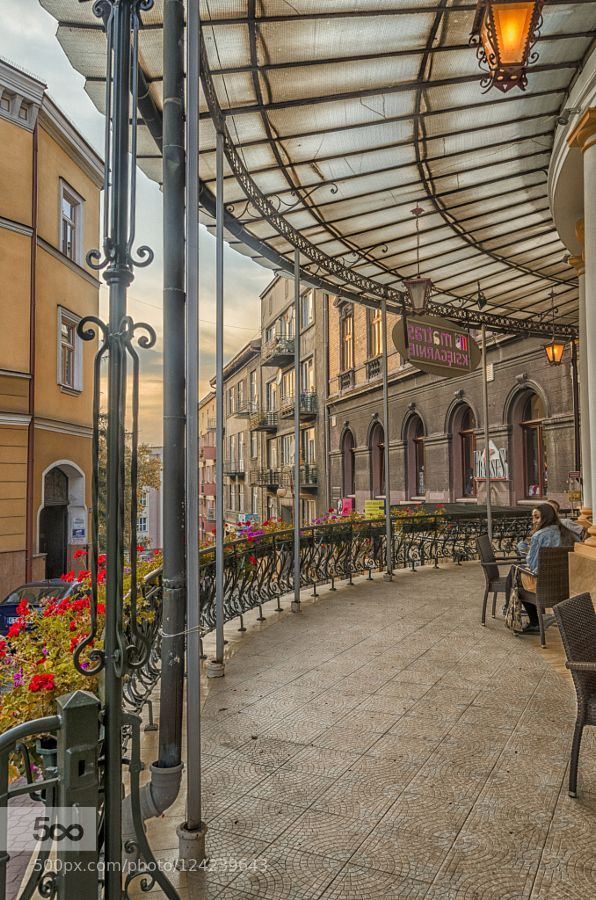 under the glass roof - Pinned by Mak Khalaf terrace - the old town - Tarnow - Poland City and Architecture EuropePolandTarnowarchitecturebuildingbuildingscitycityscapecloudslightskystreetsunsetterraceurban by mlatocha