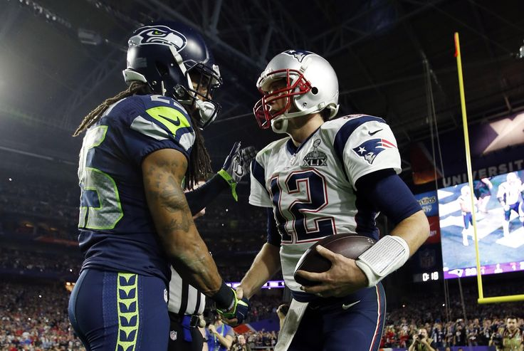 Feb 1, 2015; Glendale, AZ, USA; Seattle Seahawks cornerback Richard Sherman (left) shakes hands with New England Patriots quarterback Tom Brady (12) after Super Bowl XLIX at University of Phoenix Stadium. (Mark J. Rebilas-USA TODAY Sports)