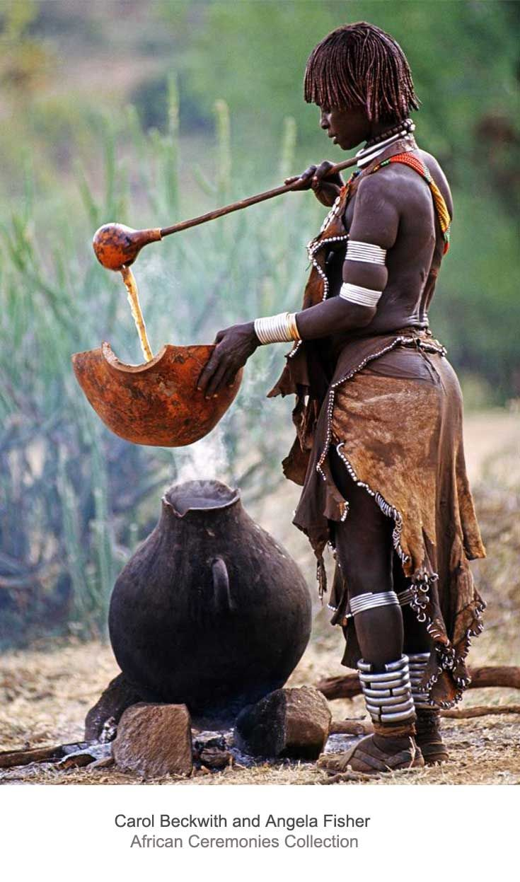 Africa | Hamar woman preparing ritual coffee over open fire for jumping-the-bull ceremonies recent initiates receive a calabash of ritual coffee. Omo Valley, Ethiopia. | ©Carol Beckwith and Angela Fisher