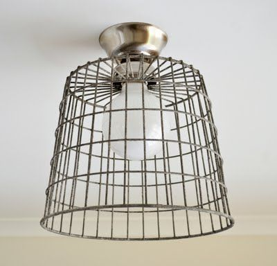 DIY Repurposed Wire Basket Ceiling Light     I know repurposed light shades aren't exactly a new idea though I did kinda just make this one up as I went along.  I really wanted a hanging pendant in the nursery though the ceiling is just too dang low so I instead opted to transform a standard batten fix (flush mount) light.    I started with this cool old zinc basket: