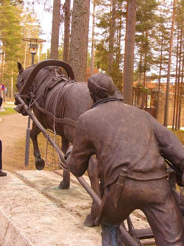"Statue ""Ajomies"" is made by artist Herman Joutsen. Exposed 1.6.1994. Statue locates in Lusto - The Finnish Forest Museum in Punkaharju, Finland"