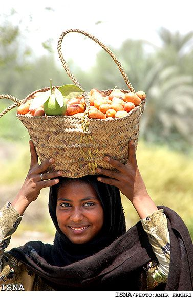 A beautiful smile goes a long way - Harvesting Dates in Minab, Iran