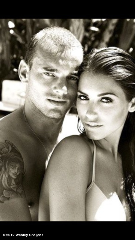 Soccer star Wesley Sneijder, and his wife.