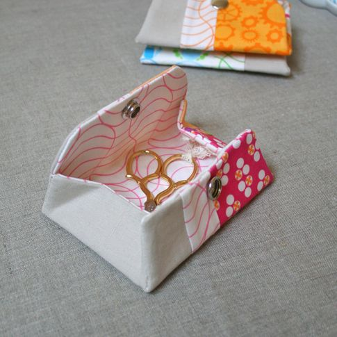 """MATERIALS  Various Cotton Prints (I used a different, coordinating print for each of the following)  2 – 4 ¼ """" x 4 ¼ """" squares  1 – 1 ½ """" x 8″ rectangle  1- 8″ x 8″ square (for lining)  Linen (Natural)  1 – 3 ¼ """" x 8″ rectangle  Fusible Interfacing  2 – 8″ x 8″ squares"""