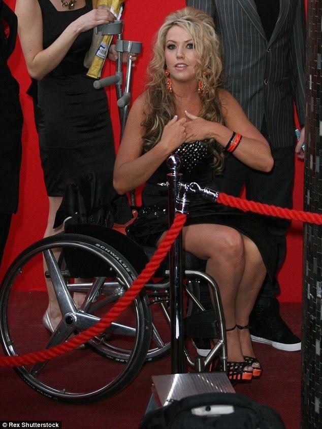 Blonde paraplegic transfer to ground