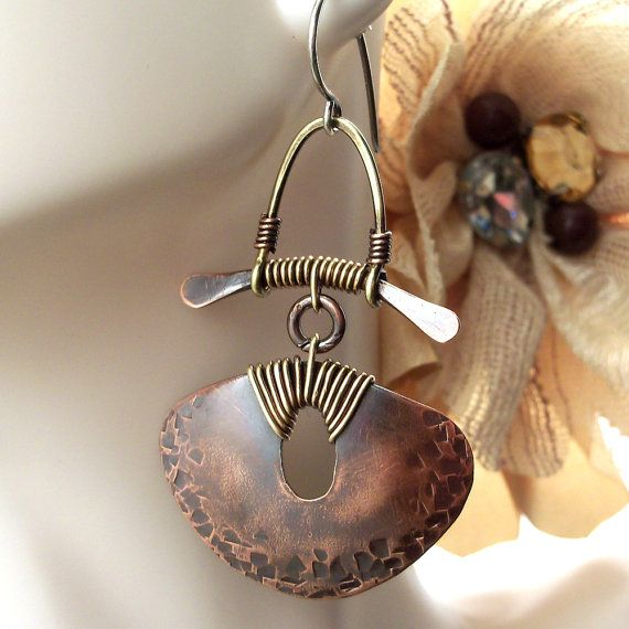 Lovely and striking Wire Wrapped Jewelry Hammered Copper Dangle Earrings. I like the wire wrapping on the top and the large paddle which balances out the big triangle disk. CMD...............  by ArtNSoulJewels