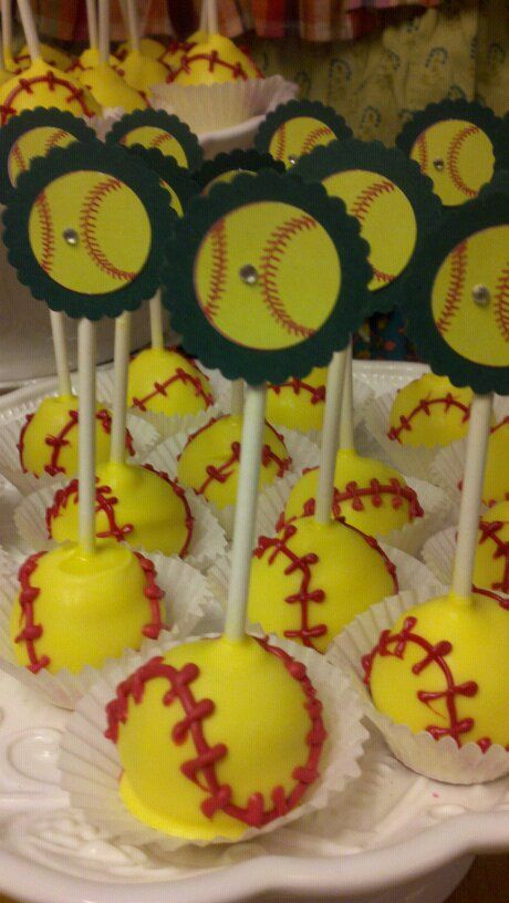 Softball cake pops...I am so happy I learned that softballs are yellow before I dipped and tagged them!