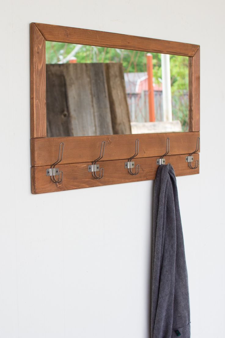 The Recycled Honey Wood Mirror With Five Coat Hooks is a dual functional…