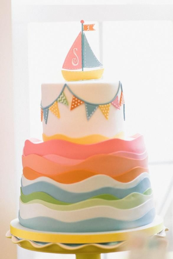 Oh my word. Do we know anyone who could make this in navy, baby blue, white and goldenrod?    Sailboat babyshower cake- adorable.  Charm City Cakes