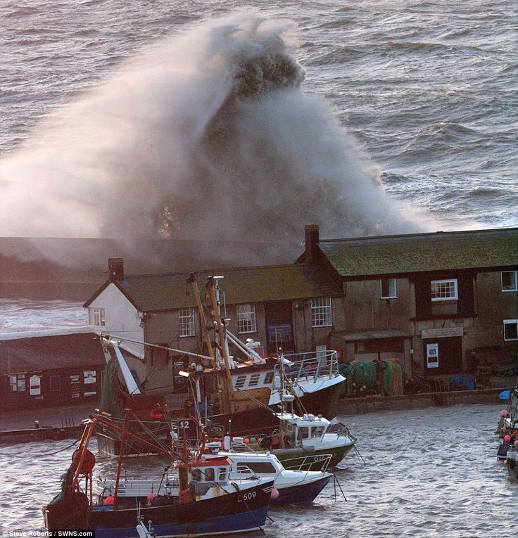 'Threat to life': High seas batter the Cobb at Lyme Regis today as thousands have been urged to pack their bags or even evacuate because of ...