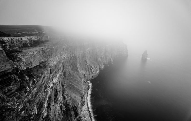 """Disappearing Act -Cliffs of Moher - The iconic Cliffs of Moher in Clare, Ireland disappearing under a sudden fog. An interesting place to visit, once second you can see for miles and another only metres. Still an enjoyable cliff walk whatever the weather :) Stay in touch: <a href=""""https://www.facebook.com/kathrynconwayphotography"""">Facebook Page</a>, <a href=""""https://instagram.com/conwaykathryn/"""">Instagram</a> or <a href=""""https://twitter.com/kcgrasshopper/"""">Twitter</a>"""