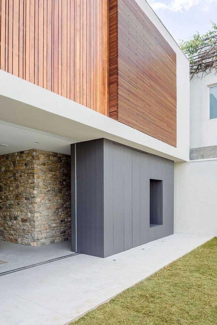 bardage claire voie vertical et horizontal, evêtement en panneaux PVC et mur en pierre
