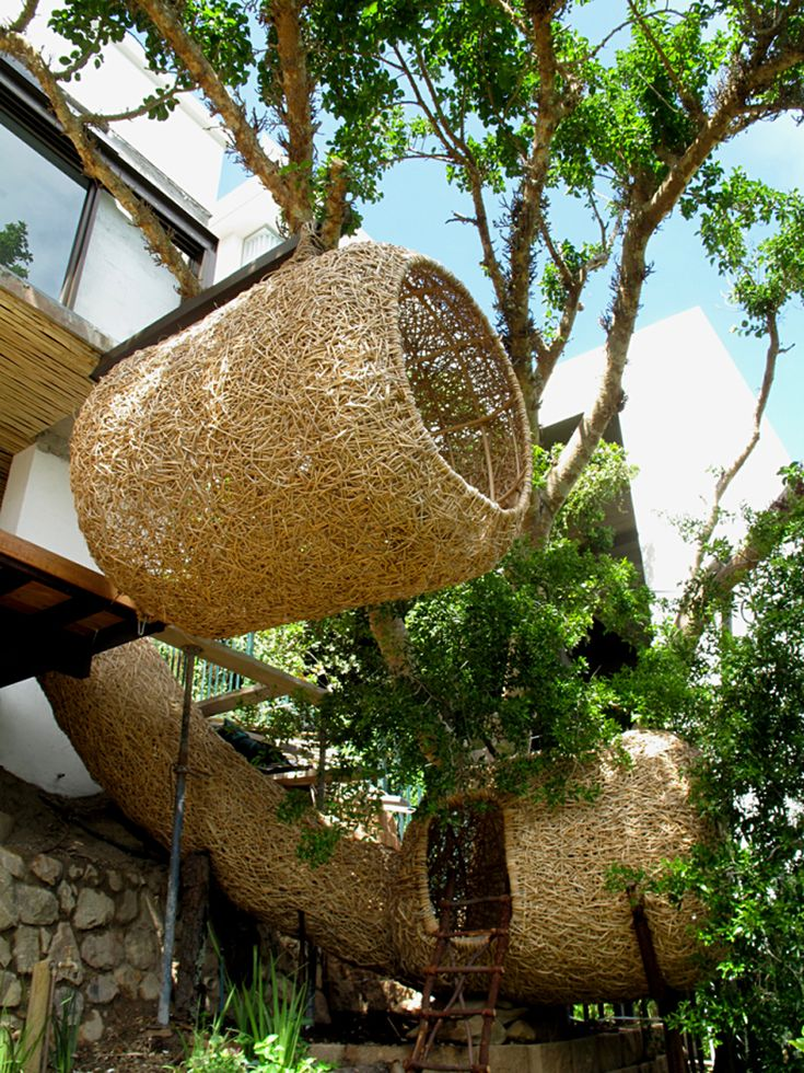 """The construction of these """"nests for humans"""" based on how weaver birds build their nests. By South African designer Porky Hefer of the firm Animal Farm."""