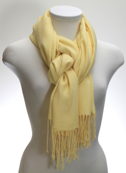 Someone asked how to tie a scarf this way, and this was the reply: I'm thinking you prob just fold the scarf in half, bring around your neck. Instead of putting put ends through the loop just put one through. Then put the second one through the opposite way. (Over instead of under) :)