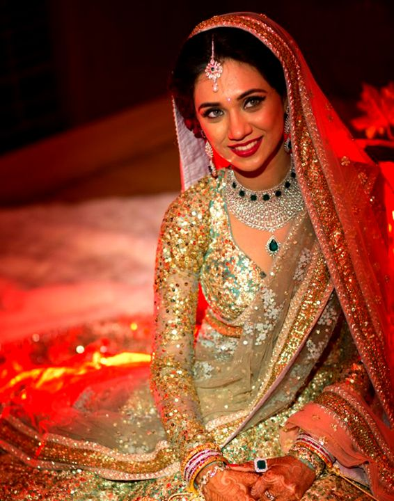This bride totally owns her look in this glamorous gold Sabyasachi lehenga as seen at the Band Baaja Bride show. Photo courtesy Ndtv India. Book your dream wedding lehenga by Sabyasachi. Write to us to know more by our stylist at www.bridelan.com