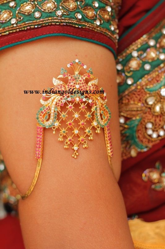 22k gold gorgeous peacock bridal ara vanki studded with rubies ,emeralds and czs