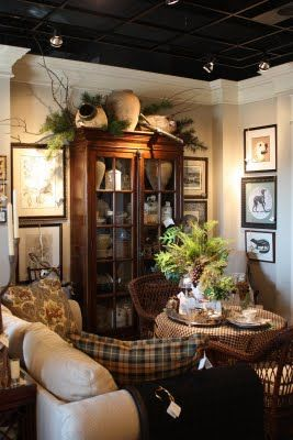 Sweet breakfast nook-  Like the artwood, the check and floral pillows and the pops of black that play off the ceiling color