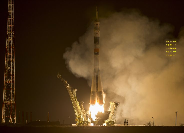 Year in Space Flight for Russian/American Crew Starts With Spectacular Night Launch and Station Docking